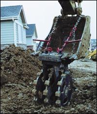 Action Equipment compaction wheel attachment