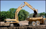Caterpillar's 330C excavator filling a truck