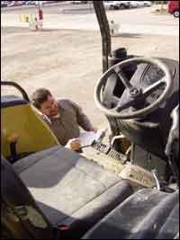 Lioi double-checks a mechanic's inspection report.