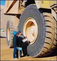 Mechanic Kevin Kelly (right) interviews truck driver John Melendrez.