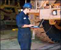 Gary Anderson, mechanic, downloads data from a trucks' onboard computer as part of a Pre-PM.