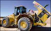 Jim Anderson servicing a loader.
