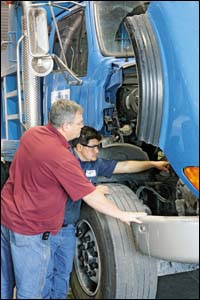 Gregory investigates a truck problem discovered by technician Cesar Sanchez.