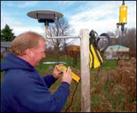 Chrisman checks one of two base stations.