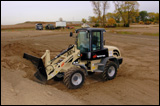 WL-440 wheel loader aggressively engages a tough stockpile