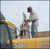 350D LC excavator with auxiliary fuel tanks for testing