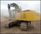 350D excavator's exhaust fan blasts out a cloud of dust