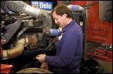 Technician checking oil