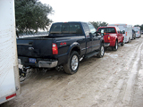 Ford F-250, 350 and 450 trucks with trailers attached