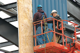 Two workers in an aerial-work platform