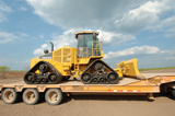 Deere 764 HSD loaded for transport