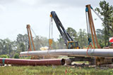 Volvo PL4611 excavator-style pipelayer being demonstrated on a Texas project
