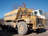 1983 Caterpillar 769C truck repowered with a new 3408E engine