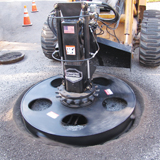 Coneqtec Universal HS 57 manhole tool attachment for skid steer loader