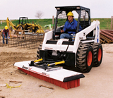 Trynex SweepEx Mega 600 broom attachment for skid steer loaders